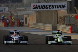 Jenson Button, Brawn GP y Robert Kubica, BMW Sauber F1 Team