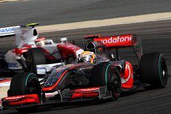 Lewis Hamilton, McLaren Mercedes leads Timo Glock, Toyota F1 Team