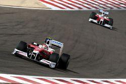 Timo Glock, Toyota F1 Team leads Jarno Trulli, Toyota F1 Team