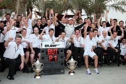 Brawn GP celebration: Jenson Button celebrates win with teammate Rubens Barrichello and Brawn GP team members