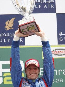 Luiz Razia celebrates his first GP2 Asia victory on the podium