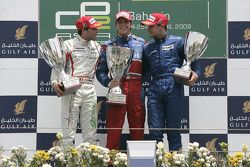 Luiz Razia celebrates his first GP2 Asia win on the podium with Jerome D'Ambrosio and Davide Rigon