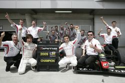Kamui Kobayashi and Jerome D'Ambrosio celebrate first and second positions in the GP2 Asia Champions