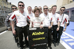 Kamui Kobayashi celebrates his GP2 Asia championship with his team who also collected the team champ
