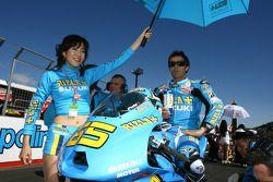 Loris Capirossi, Rizla Suzuki MotoGP with his umbrella girl