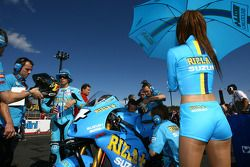Chris Vermeulen, Rizla Suzuki MotoGP with his umbrella girl