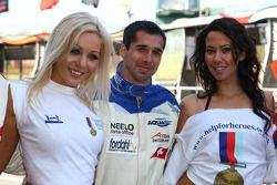 Neel Jani, driver of A1 Team Switzerland with the help for Heros girls