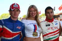 Dan Clarke, driver of A1 Team Great Britain and Daniel Morad, driver of A1 Team Lebanon with the help for Heros girls