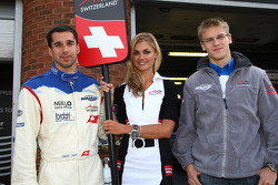 Neel Jani, driver of A1 Team Switzerland and Alexandre Imperatori, driver of A1 Team Switzerland with a grid girl