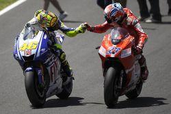 Race winner Valentino Rossi, Fiat Yamaha Team celebrates with Casey Stoner, Ducati Marlboro Team
