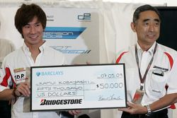 Kamui Kobayashi 2009 GP2 Asia Champion collects his prize from Hiroshi Yasukawa, Director of Bridges