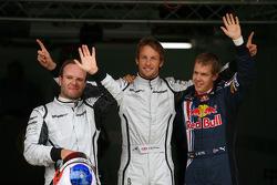 Rubens Barrichello, Brawn GP, pole winner Jenson Button, Brawn GP and Sebastian Vettel, Red Bull Racing