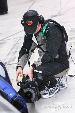A TV crew member gets ready