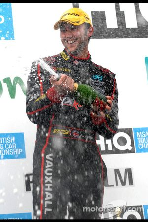 Andrew Jordan sprays champagne for second