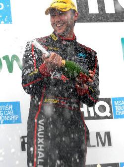 Andrew Jordan sprays champagne for second