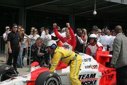 Race winner Helio Castroneves is taken to victory lane