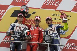 Podium: race winner Casey Stoner, second place Jorge Lorenzo, third place Valentino Rossi