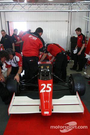 Engineers work on the car of Milos Pavlovic