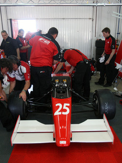 Engineers work on the car of Milos Pavlovic