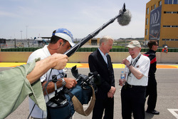 Max Mosley FIA President and John Surtees on the grid