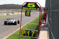 Martin Brundle holds the pitboard for his son Alex Brundle
