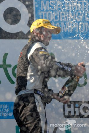 James Thompson sprays champagne