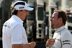 Robert Kubica, BMW Sauber F1 Team with Rubens Barrichello, Brawn GP