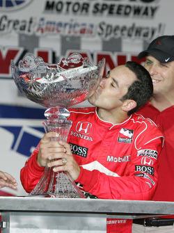 Victory lane: race winner Helio Castroneves, Team Penske, celebrates