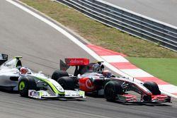 Heikki Kovalainen, McLaren Mercedes, Rubens Barrichello, Brawn GP