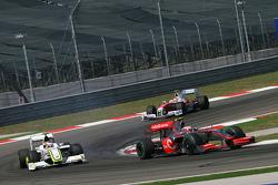 Heikki Kovalainen, McLaren Mercedes and Rubens Barrichello, Brawn GP