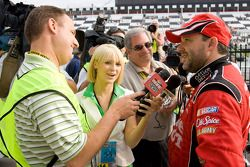 Victory lane: race winner Tony Stewart, Stewart-Haas Racing Chevrolet talks to media