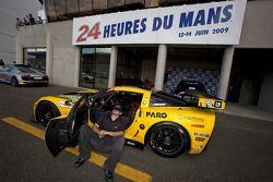 Corvette Racing team member takes a brake prior to tech inspection