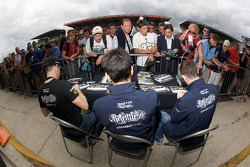 Danny Watts, Peter Hardman and Nick Leventis sign autographs