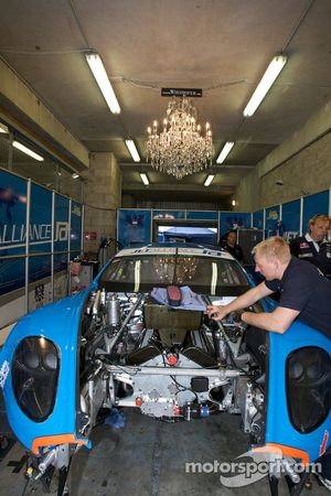 Jetalliance Racing garage with a chandelier on the ceiling