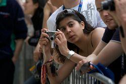 A fan takes a photo