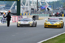 #73 Luc Alphand Aventures Corvette C6.R: Xavier Maassen, Yann Clairay, Julien Jousse, #63 Corvette Racing Corvette C6.R: Johnny O'Connell, Jan Magnussen, Antonio Garcia cross the finish line