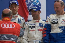 LMP1 podium: Alexander Wurz, David Brabham and Team Peugeot Total boss Olivier Quesnel receives congratulations from Head of Audi Sport Dr. Wolgang Ullrich