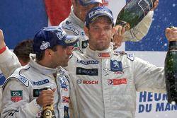 LMP1 podium: Marc Gene and Alexander Wurz celebrate with champagne