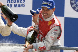 LMP1 podium: Tom Kristensen celebrates with champagne