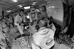 Aston Martin Racing team members work on the #009 Lola Aston Martin