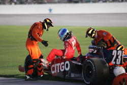 Safety workers assist Milka Duno, Dreyer & Reinbold Racing