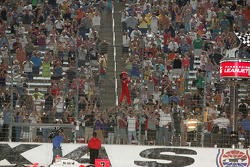 Helio Castroneves, Team Penske climbs the fence at Texas Motor Speedway