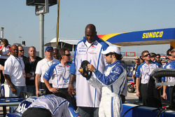 Luczo Dragon driver Raphael Matos gives Grand Marshal Shaquille O'Neal a lesson on an Indy Car steer
