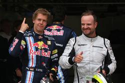 Pole winner Sebastian Vettel, Red Bull Racing, second place Rubens Barrichello, Brawn GP