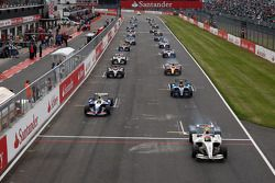 Romain Grosjean leads the field of the start line