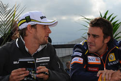 Jenson Button, Brawn GP y Fernando Alonso, Renault F1 Team