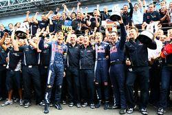 Race winner Sebastian Vettel celebrates with Red Bull Racing team members