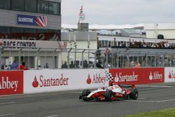 Pastor Maldonado crosses the line to take victory