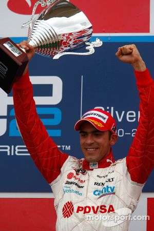 Pastor Maldonado celebrates his victory on the podium