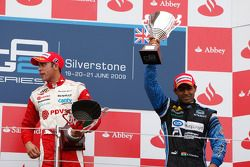 Pastor Maldonado celebrates his victory on the podium with Karun Chandhok